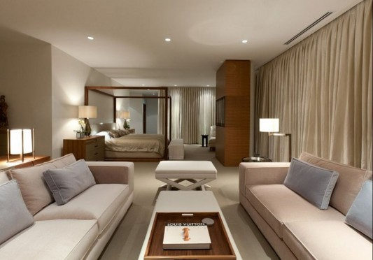 Comfortably Luxurious Penthouse in Fairmont Building bedroom with sofa