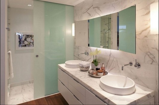 Contemporary Silversea Residence by Robert Bailey bathroom cabinet and washtafel