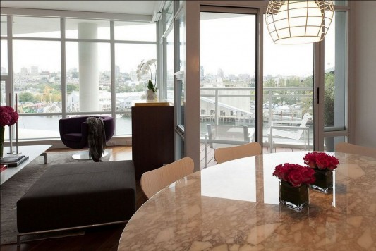 Contemporary Silversea Residence by Robert Bailey marble dining table