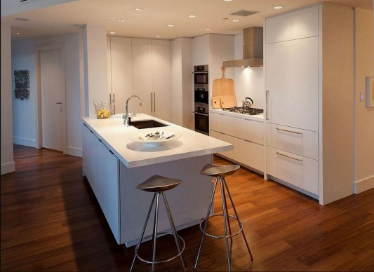 Contemporary Silversea Residence by Robert Bailey white kitchen counter