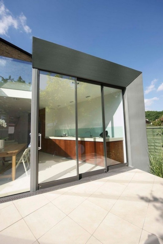 Faceted house - glass sliding door small house ideas