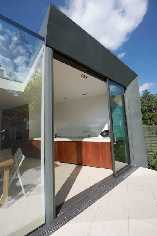 Faceted house - transparent glassed sliding door