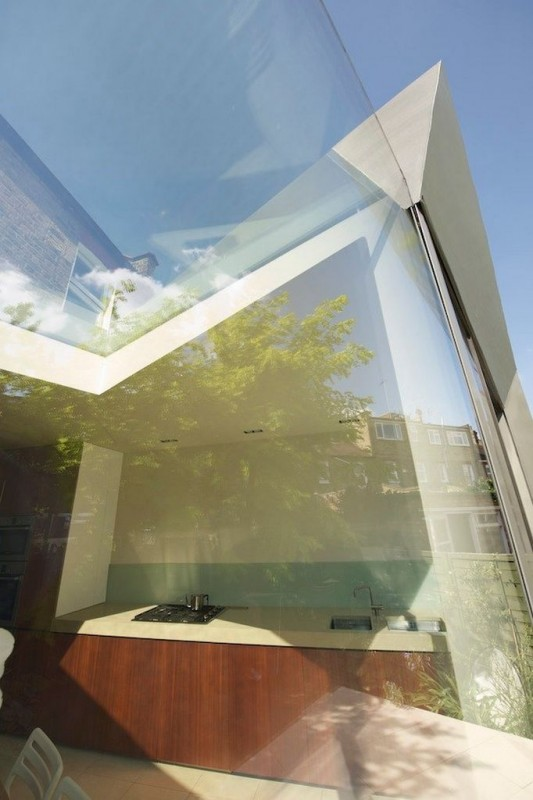 Faceted house - transparent roof and windows