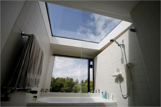 La Concha House by MOOARC bathroom with transparent roof