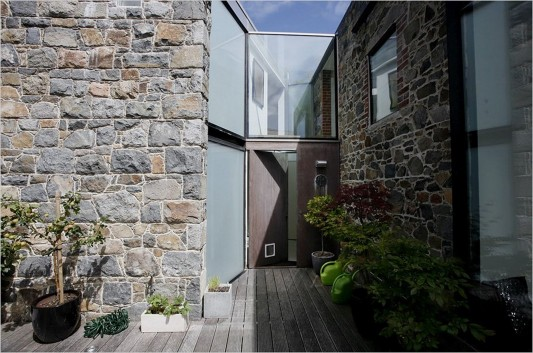 La Concha House by MOOARC stone wall and entry door