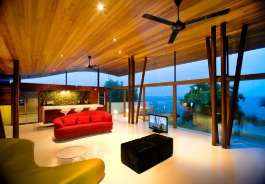 Living room opens to the beautiful scenery of sea and pool