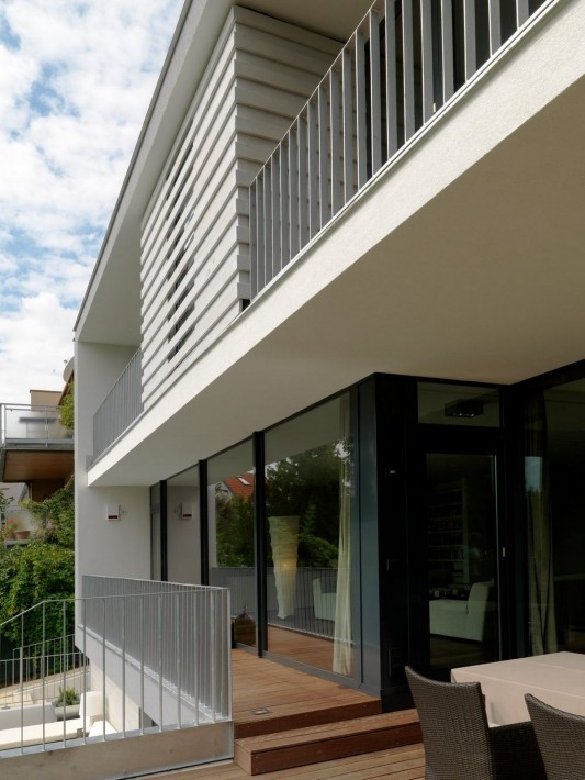 Modern Reconstruction House by Atelier Heiss Architects terrace