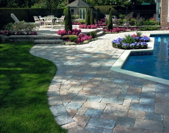 Swimming Pool Design with luxury Deck Stone