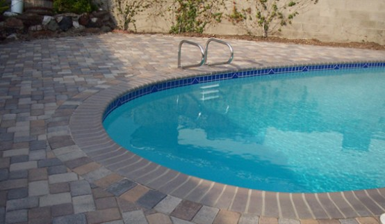 Swimming Pool Design with Traditional Deck Stone