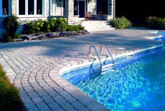 Swimming Pool Design with Cozy Design Deck Stone