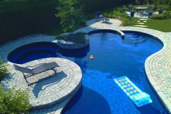 Swimming Pool Design with natural Deck Stone