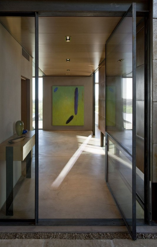 The Brown Residence by LakeFlato Architects glasses door