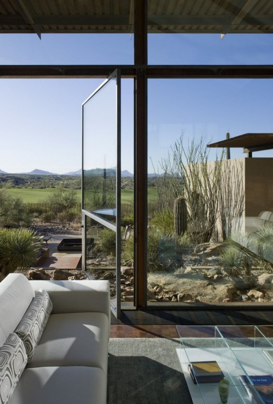 The Brown Residence by LakeFlato Architects living room with transparent windows
