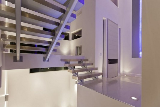 Ultra-modern residence with futuristic interior aluminum stairs design