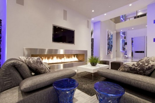 Ultra-modern residence with futuristic interior big fireplaces feature