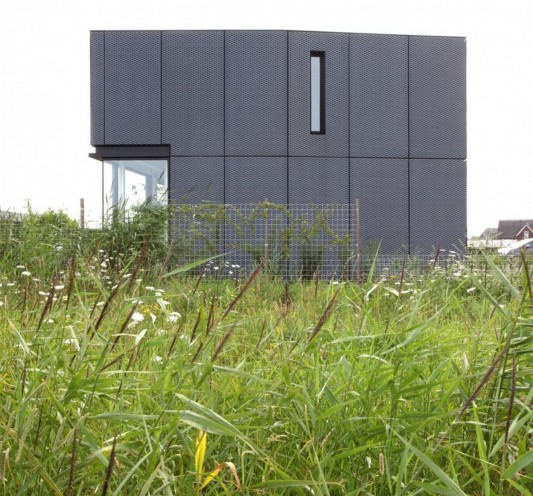 Villa DVT Beautiful Minimalist House With Aluminum Façade side view exterior