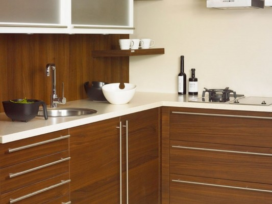 White and brown traditional kitchen with solid surface counter tops