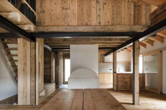 Alpine Wooden Barn Restoration by EXIT Architetti