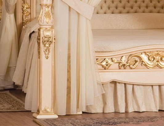 classic canopy bed with luxurious 24-carat gold ornament