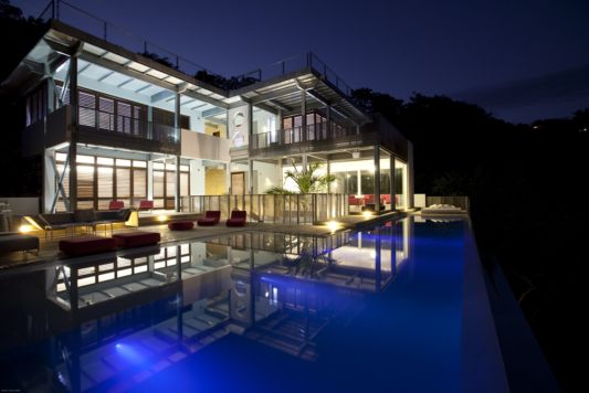 contemporary beach house at night casa torcida