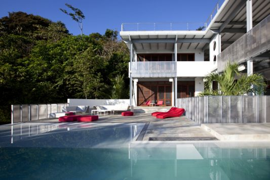 contemporary beach house with swimming pool