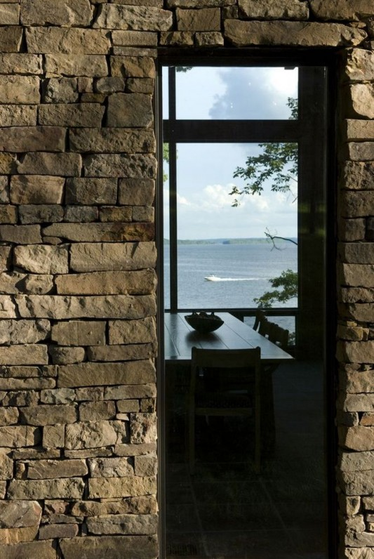 contemporary lake house stone wall design