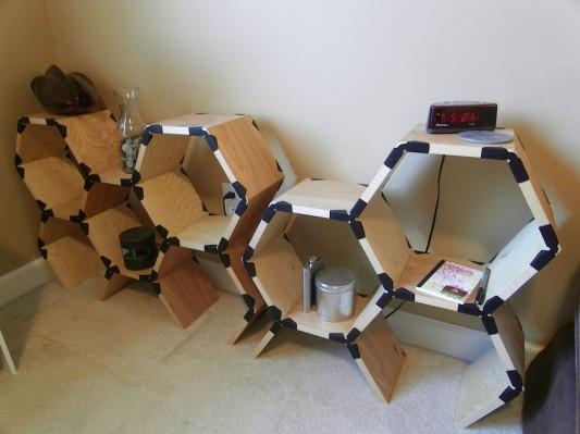 contemporary modular shelving unit with hexagonal design by sam holmes
