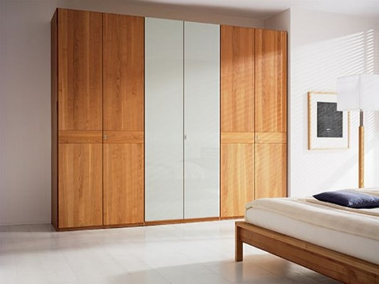 Contemporary solid wood sliding and folding door wardrobes