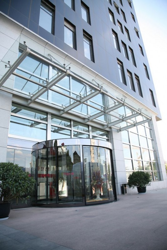 curved laminate glass contemporary revolving door system