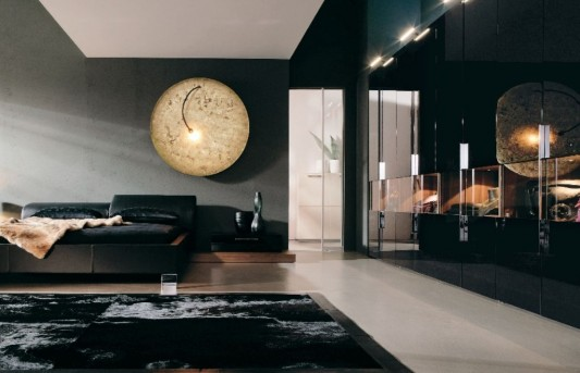 elegant black bedroom with minimalist leather beds