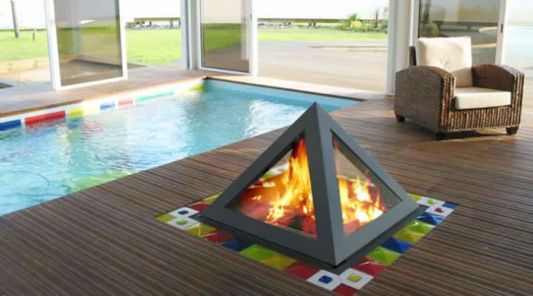 fireplace pyramid design placed beside swimmingpool