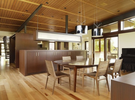 kitchen island with modern cooking utensils and wood flooring