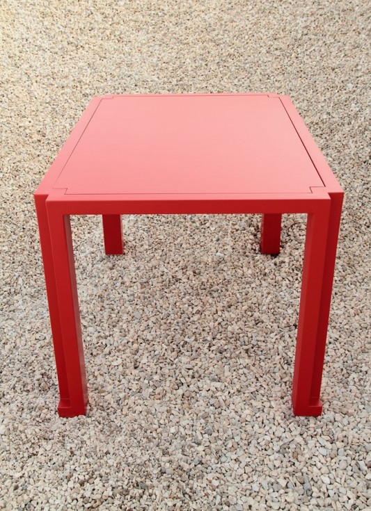 minimalist and practical table design red color