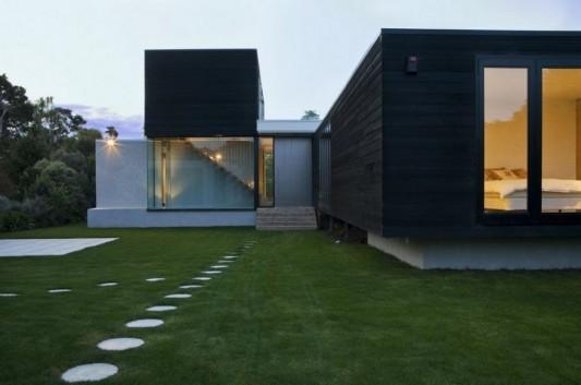 minimalist house in black and white garden