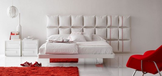 modern minimalist bed design with comfortable pillowed headboard