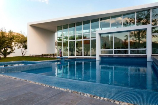 neo-modern house design blue swimming pool concept