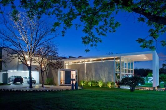 neo-modern house design with green exterior concept