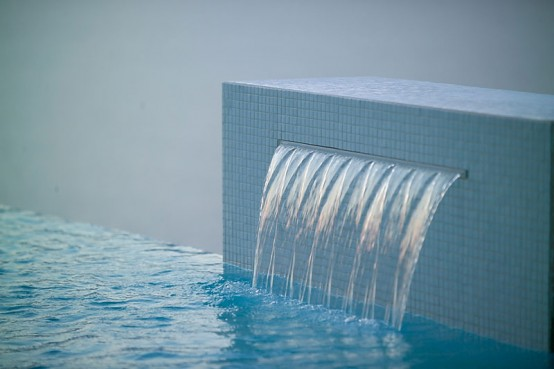 one side water fall swimming pool- fountain by zodiac pooclare