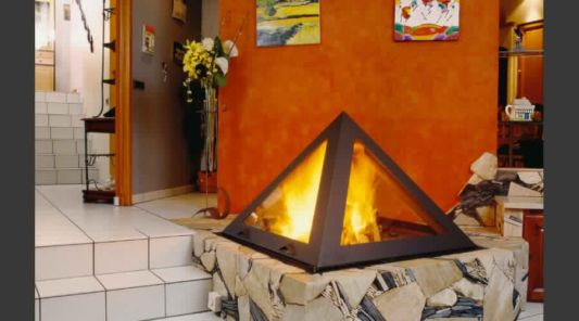 pyramid fireplace standing at stone