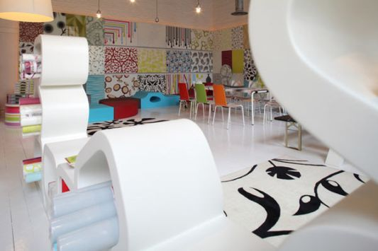 Showroom Interior Design With Colorful Wallpaper Colorful Showroom Furniture Ideas