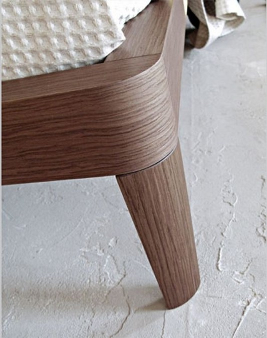 simple wooden bed legs detailed