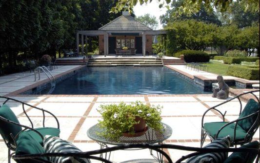 swimmingpool design with green landscape