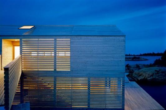 wooden floating lake house design