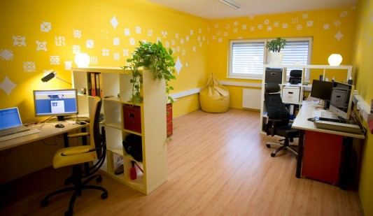 yellow modern office interior decor with funny wall decals