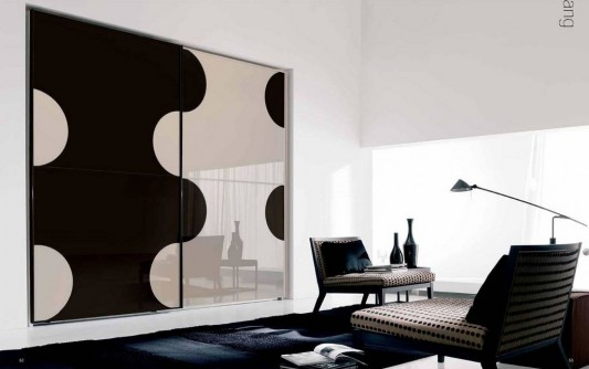 yin and yang motifs sliding door wardrobes design